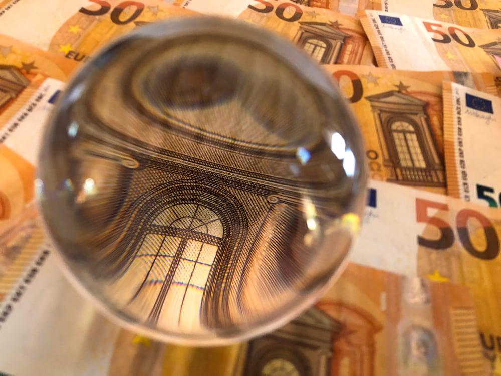 Josie Elias by Shutterstock, a 50 euro bill showing through a crystal ball