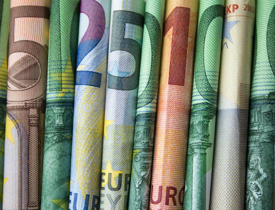 Shutterstock By hanohiki, rolled euro bills side by side